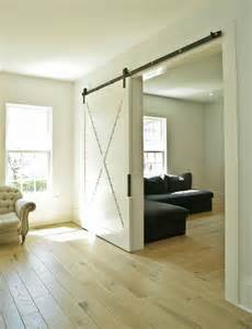 white sliding barn door bringing sliding barn doors inside