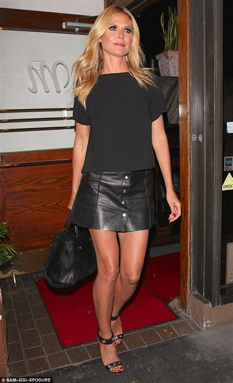 hollywood actress in mini skirt heidi klum shows off killer legs in mini skirt with