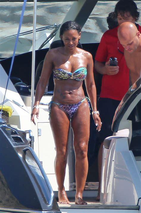 melanie brown in bikini on the beach in ibiza