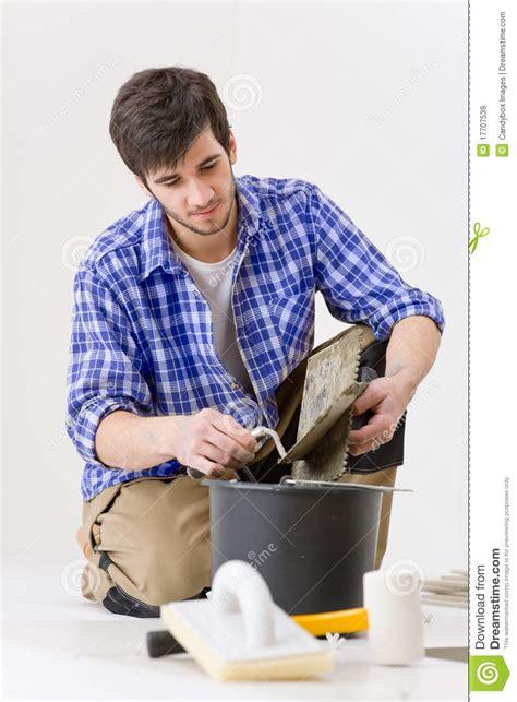 home improvement handyman laying tile royalty free stock