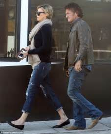 sean penn and charlize theron show just how inseparable they are as he keeps her company during