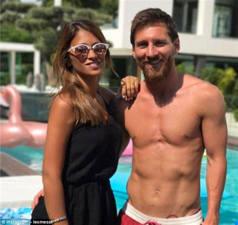 barcelona star lionel messi and his wife pictured