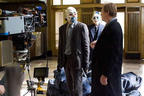 christopher nolan seeks to take moviegoers back to 1940 s behind the scenes of the dark knight trilogy sci fi design
