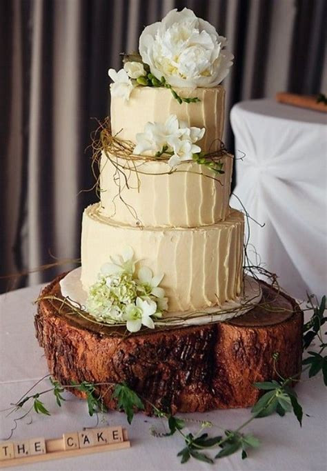 rustic forest themed wedding cake or did you want cupcakes orchids peonies and lilies will be