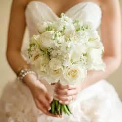 white bouquet all white and ranunculus bouquet wedding flowers photos brides