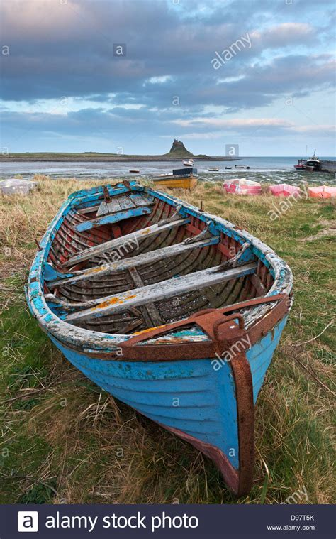 old fishing boat images old fishing boat pulled up on the shore at holy island