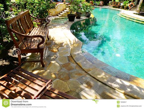 sunny outdoor swimming pool  patio furniture stock