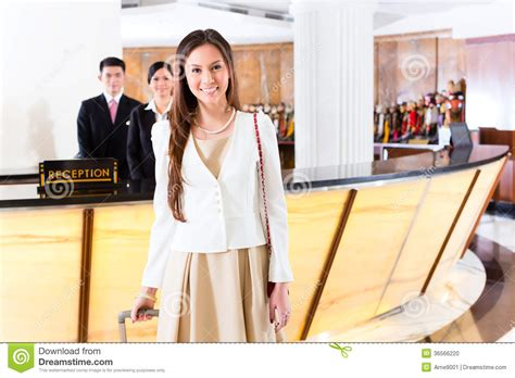 Front Desk For Business by Arriving At Hotel Front Desk Stock