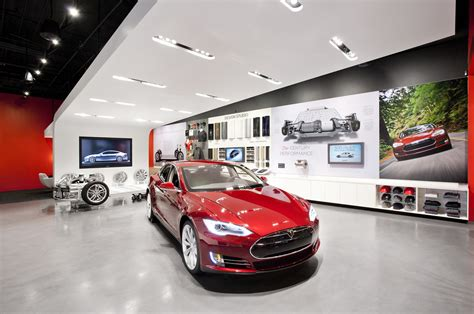 auto dealer groups escalate battle  tesla stores