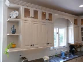 Adding Cabinets Above Kitchen Cabinets by Ugly Cabinets No More Traditional Kitchen Cabinetry