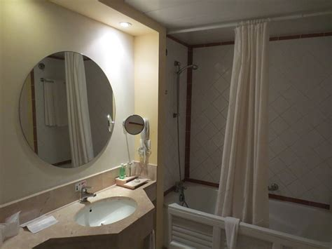 removing bathroom mirror glued how to remove a mirror that is glued to the wall see
