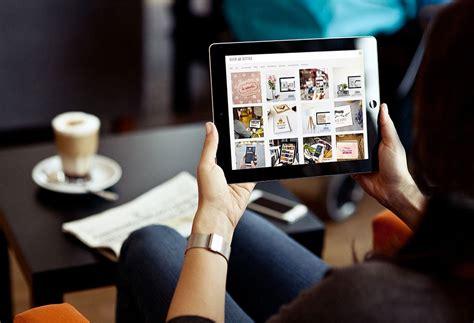 Woman looking at iPad Mockup   MockupWorld