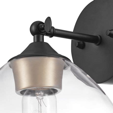 Harrow 1-Light Matte Black Wall Sconce With Clear Glass Shade.
