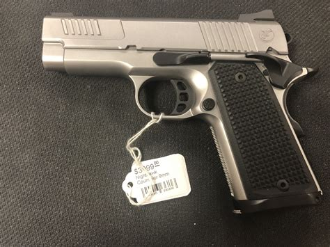 Nighthawk Custom Parts And Accessories Including 1911 Grips.