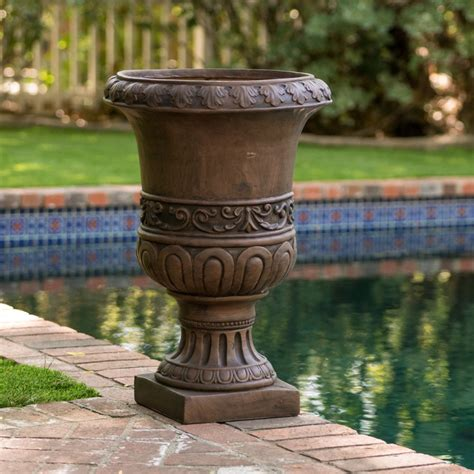 Roma 26-Inch Antique Brown Urn Planter For Sale Online.