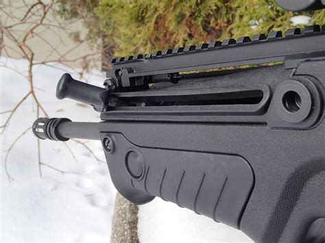 The Tavor S Non-Reciprocating Charging Handle  - Pinterest.