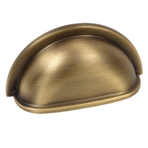Brass Antique Brass Cup Pulls.