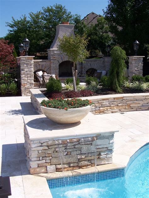 backyard planters with waterfalls around pools