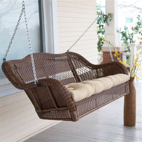 brown resin wicker porch swing