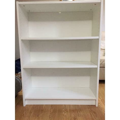 deep white bookshelves