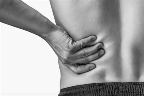 dull back pain left side under rib cage