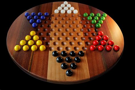Game With Marbles And Board