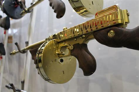 Tommy-Gun Gold Tommy Gun With Snake Skin Handles.