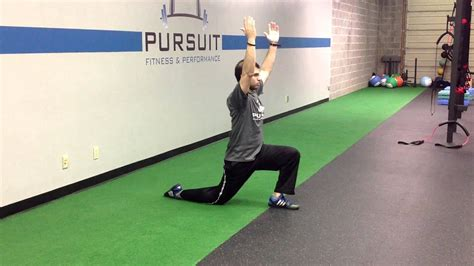 half kneeling hip flexor stretch with reach over the phone