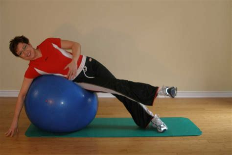 heel to hip stretches exercise yoga ball