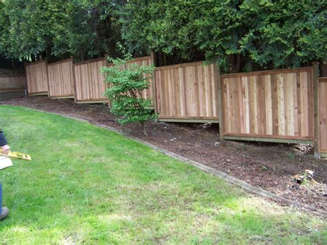 how to build wood fence on slope