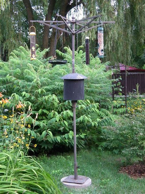 how to put a bird feeder on a pole