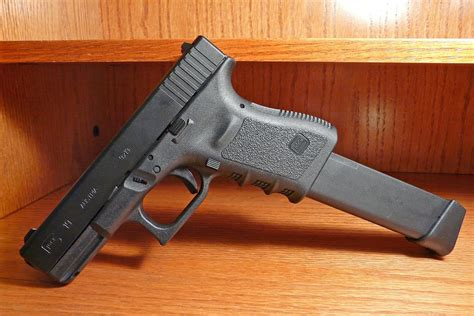 Gunkeyword How Many Rounds Does A Glock 23.