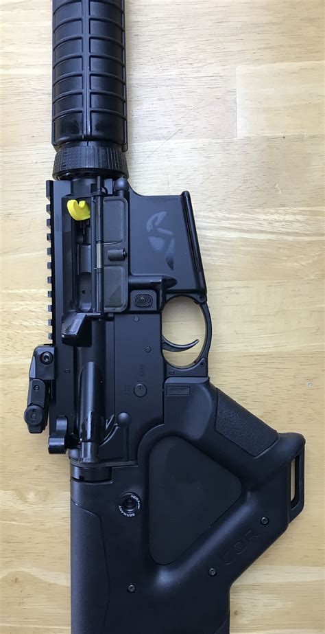 Ruger-Question Is The Plastic Nameplate On A Ruger Ar-556 Removable.