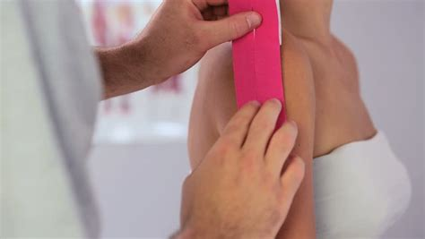 kinesio tape hip flexor and abstract wallpaper blue