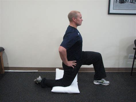 kneeling hip flexor stretch foot elevated lunge exercise class