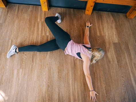 laying on back hip flexor stretch exercise