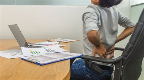 lower back pain caused by sitting too long