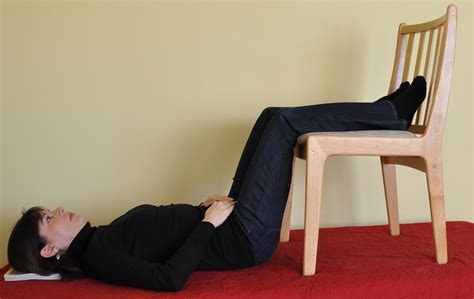 pain in lower back and legs when lying down