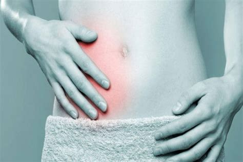 pain in lower right abdomen when sitting up