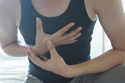 pain in right side breast area