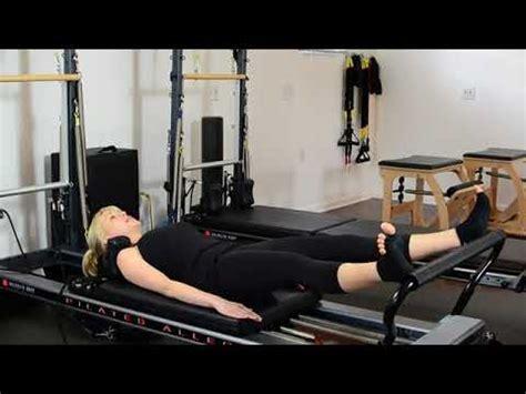 pilates reformer hip flexor exercises with resistance tube