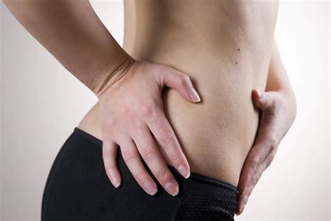 sharp pain in lower right stomach female