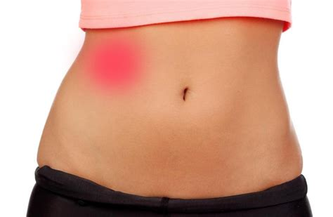 sharp pain in right side of stomach female