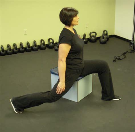 stretch hip flexors while sitting