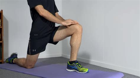 stretch your hip flexors by leaning against refrigerators