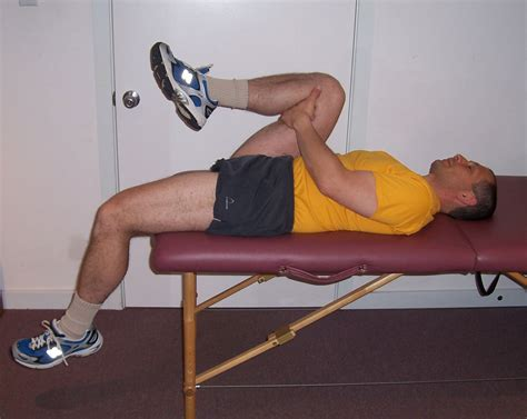 table hip flexor stretch with a rope