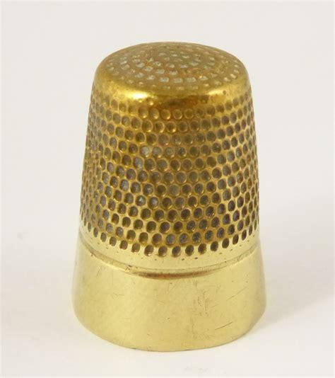 Brass The Brass Thimble.