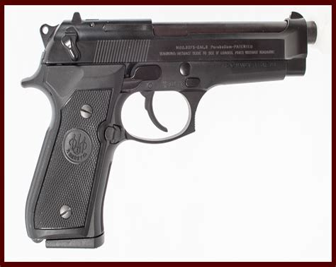 Beretta The Kickback Of A Beretta Pistol.