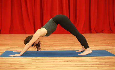 tight hip flexors painful downward dog yoga coralville