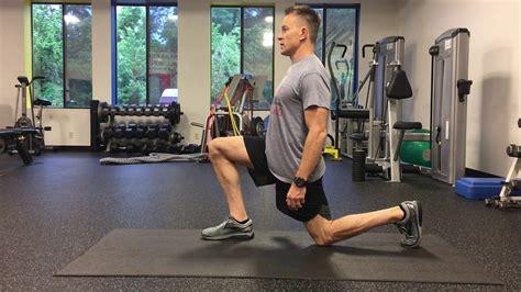 trx half kneeling hip flexor stretch against a wall